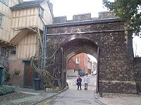 15th Century Prior's Gate. Main entrance to The Close. Plain four-centred arch with original traceried doors. Coat of arms aver arch. Castellated parapet.     15th Century Porter's Lodge. Similar to Cheyney Court and forming a 2-storey projecting gabled part of the Cheyney Court block.