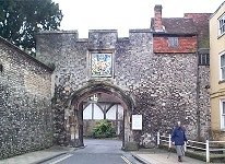 15th Century Prior's Gate. Main entrance to The Close. Plain four-centred arch with original traceried doors. Coat of arms aver arch. Castellated parapet.