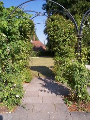 View through the Arbour to the Presbytery Lawn