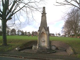 Oram's Arbour & Drinking Fountain  19th Century Littlehales Memorial. Square, carved stone fountain in shape of Gothic crocketted pinnacle. Two basins. Dated 1880. Formerly outside the Westgate.     SU 476 297